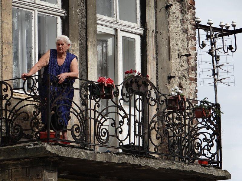 Elderly Woman on Balcony
